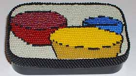 Completed beadwork mounted on metal box