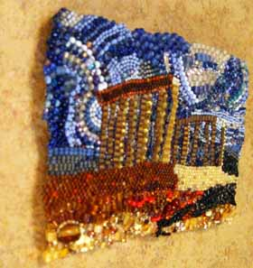 Beadwork is mounted to tile with Velcro which elevates it above the surface.
